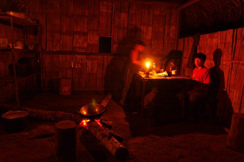 ecuador, macas, shuar, indian, village, amazon, jungle, oriente, house, hut, candle, evening